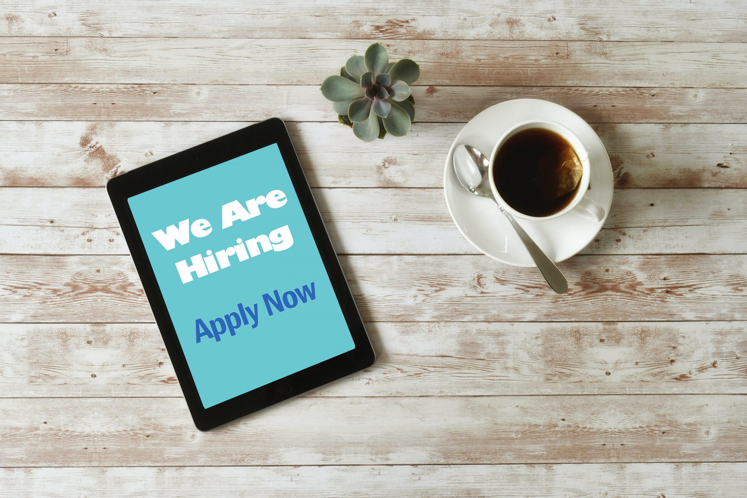 online-job-search-we-are-hiring-apply-now-on-table-HMHYM3F